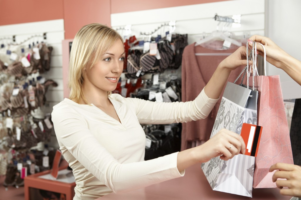 The woman pays off in a boutique